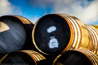 A stack of barrels in the yard